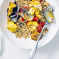Curried cauliflower traybake with chilli herb yogurt