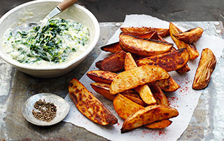 Spiced wedges with cheesy baby leaf greens