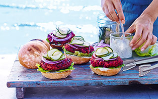Beetroot burgers with soused cucumbers, soured cream & dill