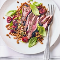 Seared duck with balsamic cherries, basil & freekeh