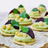 Vegan coriander hummus and beetroot blinis