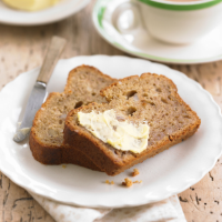 Banana bread with cinnamon and chopped nuts