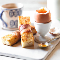 Easter eggs with crispy egg & bacon soldiers