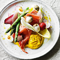 Quail eggs, serrano ham & vegetables with saffron allioli