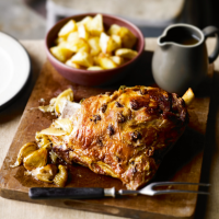 Slow-roast shoulder of lamb with anchovy, oregano & garlic with roast potatoes