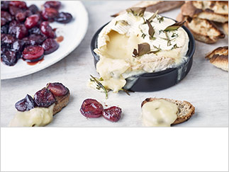 Baked Camembert with cherries and herbs