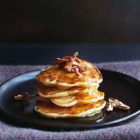 Pear and buttermilk pancakes with maple syrup