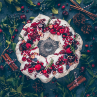 Cherry pomegranate pavlova