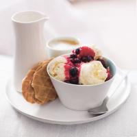Cardamom cloud ice cream with warm berry sauce