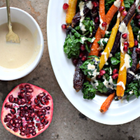 Food To Glow rainbow carrots & flower sprouts with roasted garlic & tahini drizzle