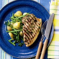 Pork chops with potato, spinach and green beans