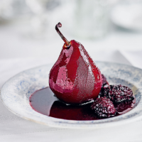Pears in blackberry & red wine sauce