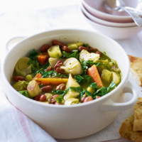 A Spring vegetable casserole with garlic bread dish