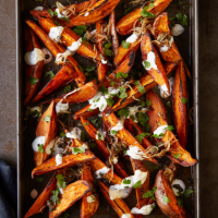Sweet potato wedges with garlic and herb dressing, frizzled shallots and capers