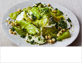 Braised cabbage with goats' cheese, hazelnuts & parsley oil