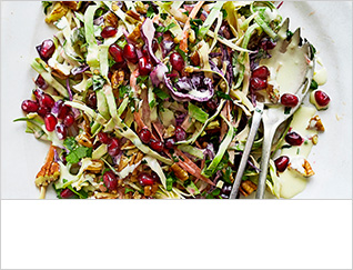 Cabbage, apple and carrot slaw with pecans and pomegranate