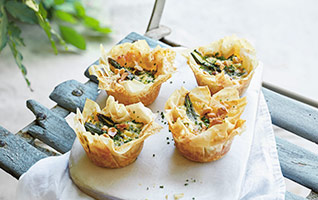 Mini asparagus, blue cheese and hazelnut tarts