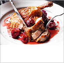 Roast duck with clementine & cherry sauce
