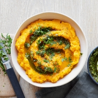 Carrot and swede mash with roasted garlic, parsley and walnut pesto