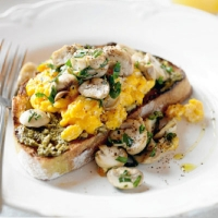 Scrambled eggs with mushrooms on truffle-pesto sourdough toast
