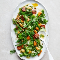 Warm herb salad with chorizo & butter beans