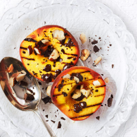 Griddled peaches with hazelhuts and melting chocolate