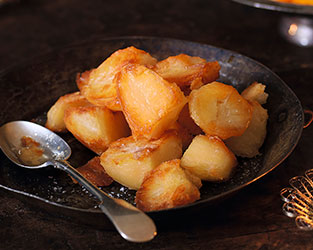 Heston's herb roast potatoes