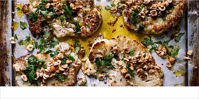 Roast cauliflower steaks with crushed hazelnuts and saffron