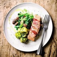 Pancetta salmon with creamed vegetables