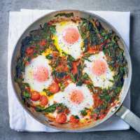 Baked eggs with spinach, tomato, red pepper & chorizo sauce