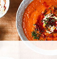 Tomato, red pepper and sweet potato soup with harissa yogurt