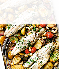 Baked sea bass with new potatoes, tomatoes  & roasted cashews