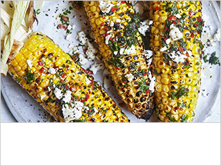 Barbecued sweetcorn with red chilli butter and feta