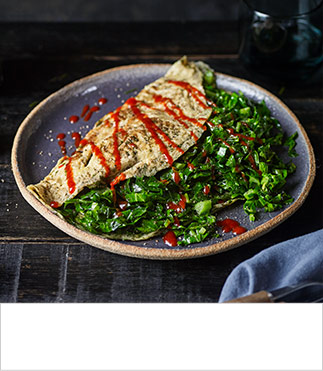 Baby greens omelettes with garlic and chilli sauce