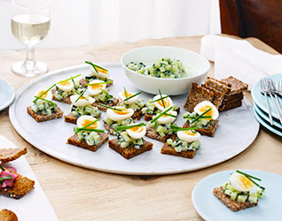 Quail's eggs and pickled cucumber on rye