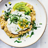 Quick red lentil dhal with fried egg, avocado & herbs