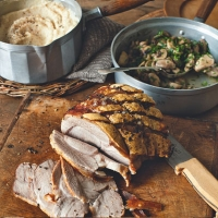 Roast pork with celeriac purée and garlicky mushrooms