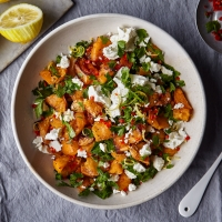 Smashed swede with feta, chilli and parsley