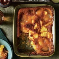 Sticky pineapple pudding with coconut custard
