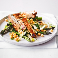 Warm salad of seared harissa chicken with fennel, asparagus & chickpeas