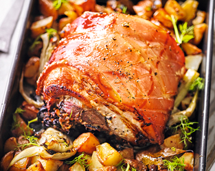 Porchetta-style pork belly with garlic roasties