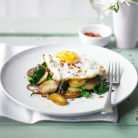 New potatoes and spring greens with chilli-fried duck eggs