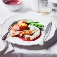 Stuffed roast pork with sage and berry sauce
