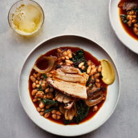 Slow-roasted pork belly with cannellini beans