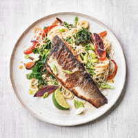 Wholegrain vegetable noodle stir fry with grilled sea bass