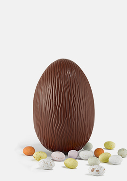 Milk chocolate Easter egg with mini speckled eggs