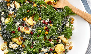 Roast cauliflower, kale and barley bowl with crunchy spiced chick peas
