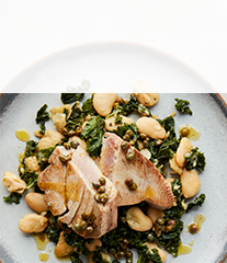Tuna steak with caper butter and kale-bean crush