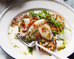 Grilled squid with rocket and sweet potato salad