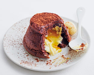 Gooey chocolate orange puddings with a 'Cream Egg' filling